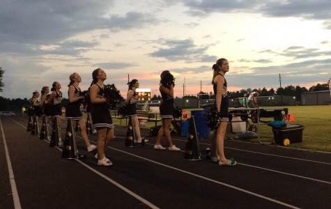 Varsity Cheerleaders at Concordia Lutheran game 9/4/2015