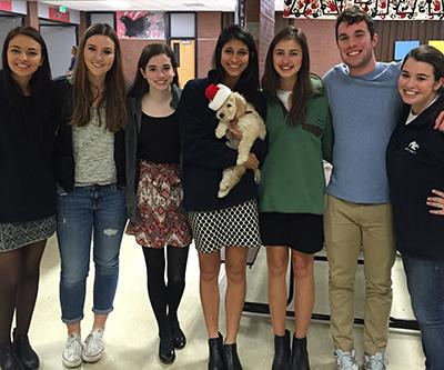 From left to right: Madison Lewis, Coach Shania Hunt (Class of 2013), Margaret Purcell, Sarah Navid holding Kimmy, Lauren Lamar, Coach Davis LaBarre (Class of 2014) and Debate Head Coach Courtney Coffman.
